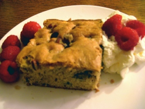 Blondie brownies with raspberries on the side