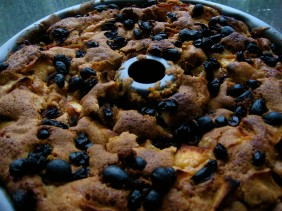 apple cake with burnt golden raisins on top