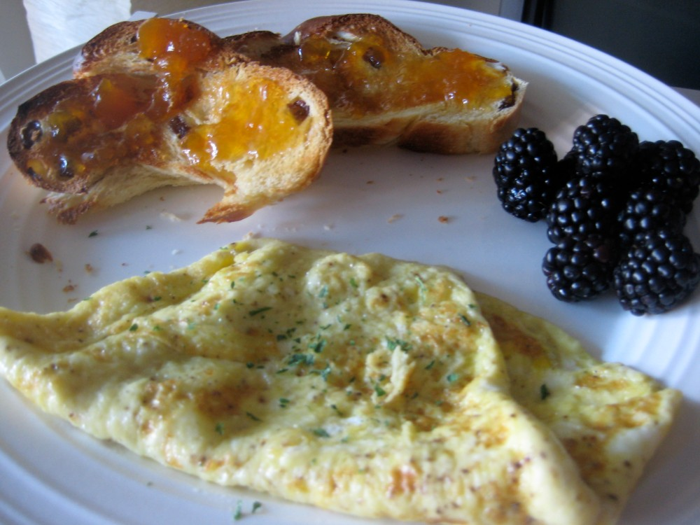 Challah with peach preserves, blackberries and a fried egg